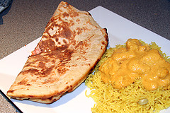 Chicken korma, rice and naan bread